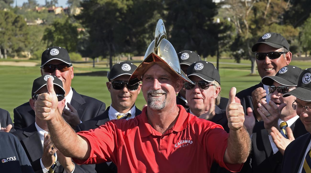 Marco Dawson wears the golden Conquistador helmet after winning the Champions Tour's Tucson Conquistadores Classic at Omni Tucson National Sunday in Tucson, Arizona.