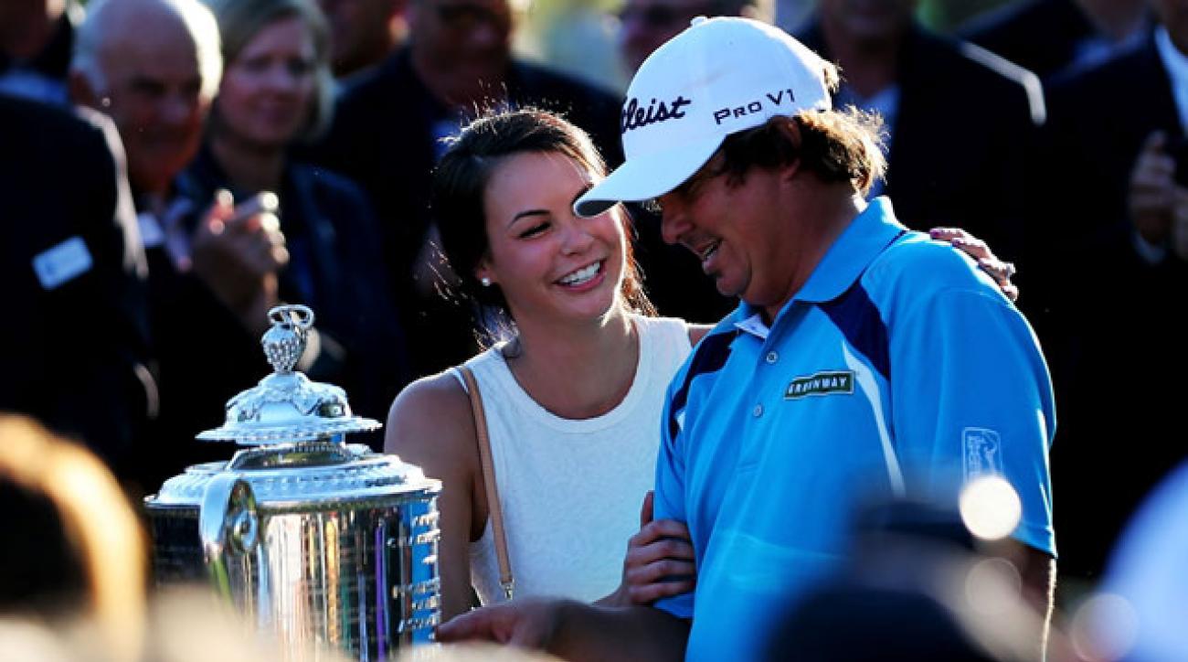 Jason and Amanda Dufner celebrate after the 2013 PGA Championship.