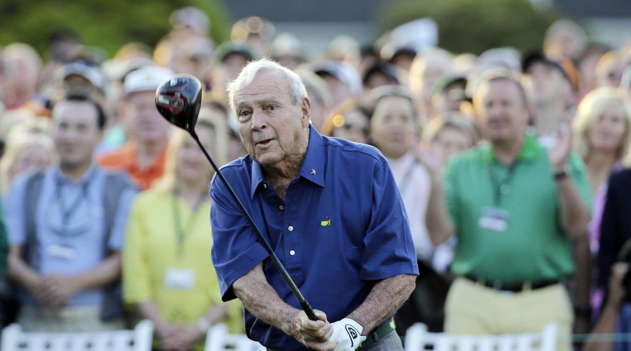 Arnold Palmer watches his tee shot for the honorary tee off before the first round of the Masters golf tournament Thursday, April 9, 2015, in Augusta, Ga. (AP Photo/David J.