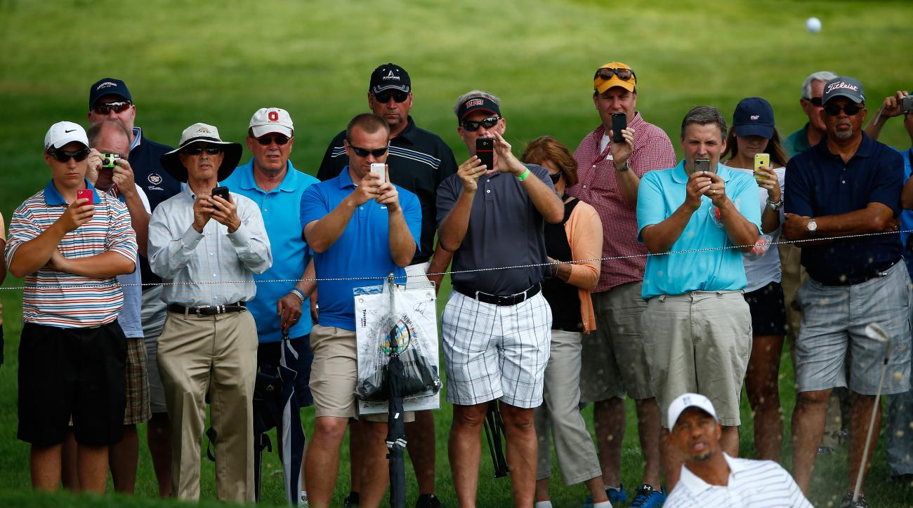 Fans photograph Tiger Woods on their cell phones during a practice round for the World Golf Championships-Bridgestone Invitational at Firestone Country Club South Course on July 30, 2014 in Akron, Ohio.