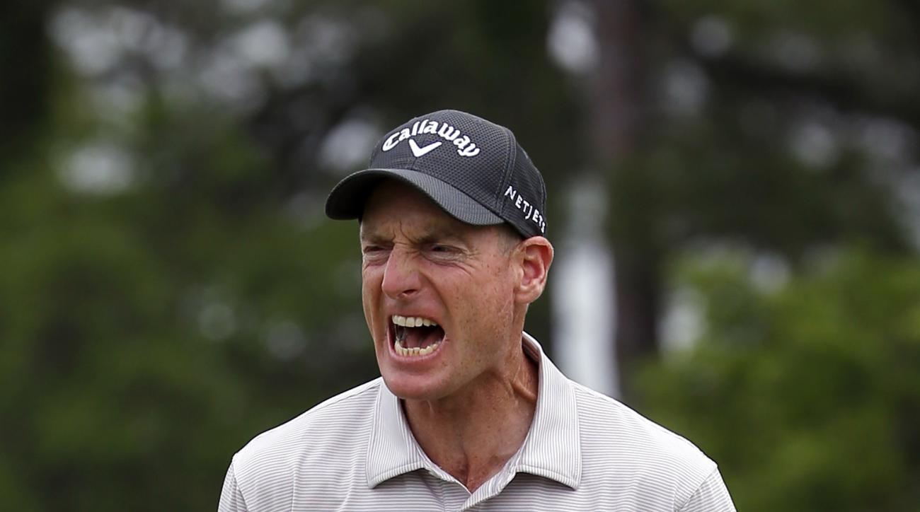 Jim Furyk reacts after his winning putt on the 17th hole against Kevin Kisner during the playoff of the RBC Heritage in Hilton Head Island, S.C., April 19, 2015.