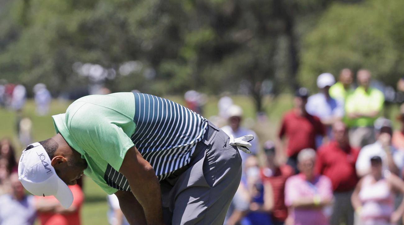 Tiger Woods reacts to a missed birdie putt on the 15th green during the third round of The Players Championship golf tournament Saturday, May 9, 2015, in Ponte Vedra Beach, Fla. (AP Photo/John