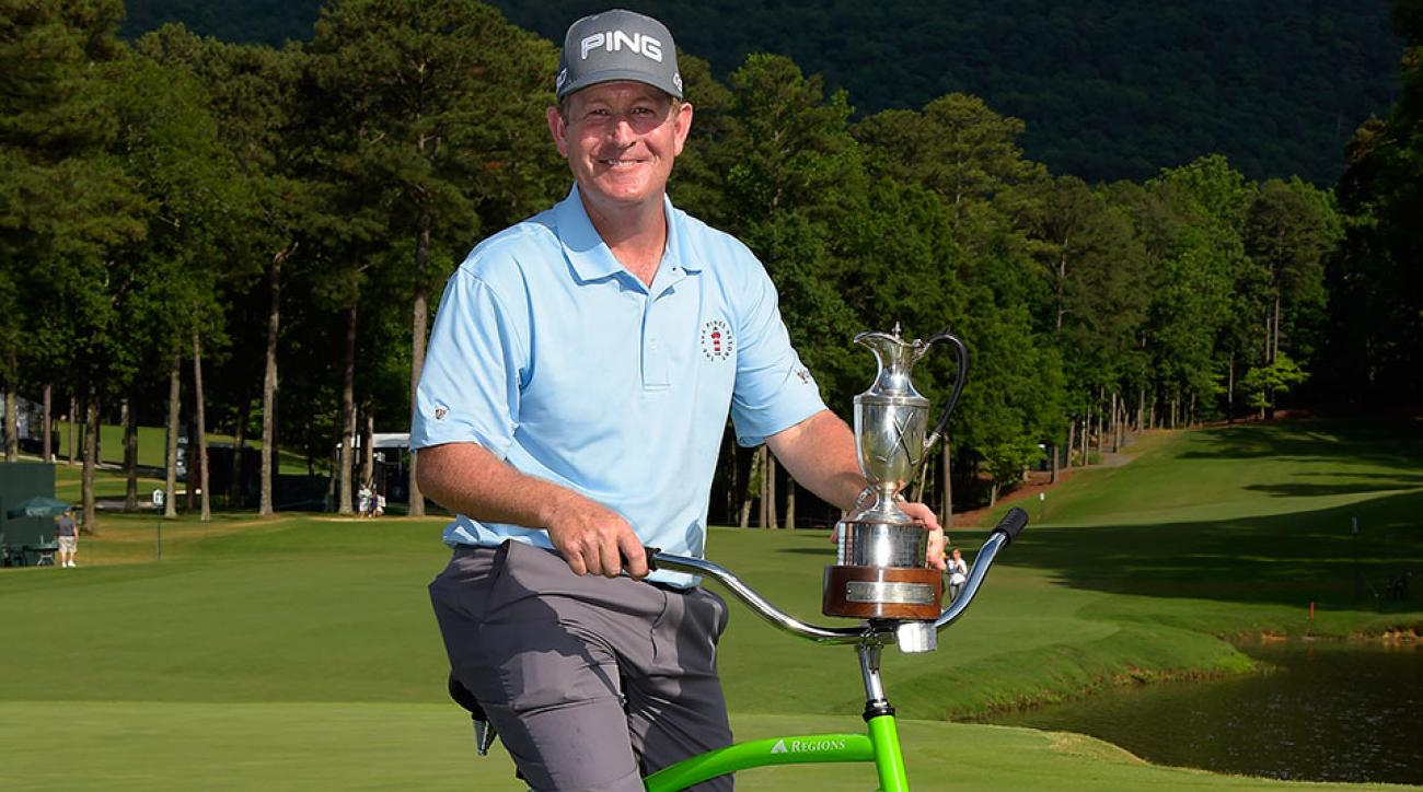 Jeff Maggert celebrates with his Regions Tradition trophy and bicycle.