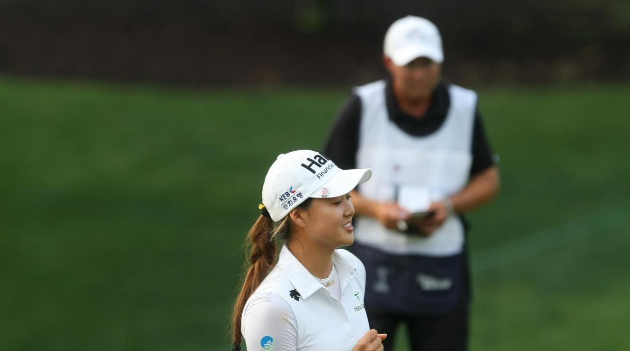 Minjee Lee pumps her fist after making birdie on the ninth hole during the final round of the LPGA Tour's Kingsmill Championship golf tournament on Sunday, May 17, 2015, in Williamsburg, Va. (AP Photo/Jason
