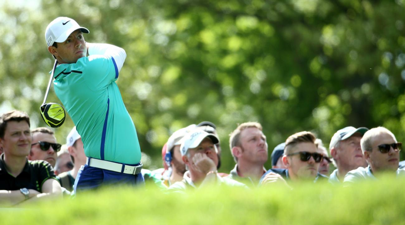 Rory McIlroy tees off on the ninth hole during the first day of the BMW PGA Championship at Wentworth on May 21, 2015, in Virginia Water, England.