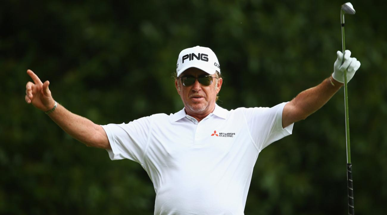 Miguel Angel Jimenez celebrates his hole-in-one on the second hole during the third round of the BMW PGA Championship at Wentworth on May 23, 2015, in Virginia Water, England.