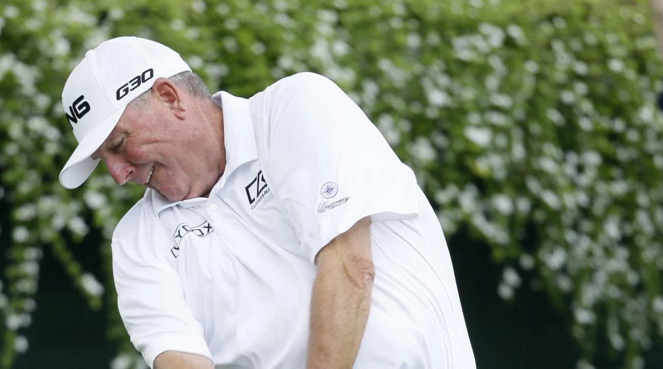 Mark Calcavecchia hits off the first tee during the first round of the Champions Tour's Principal Charity Classic golf tournament, Friday, June 5, 2015, in Des Moines, Iowa. Calcavecchia was wearing bacon themed pants in honor of a local bacon festival.