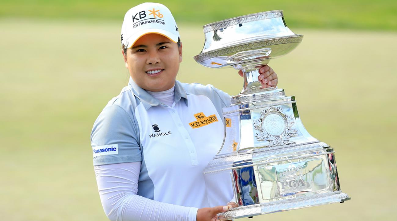 Inbee Park of South Korea proudly holds the trophy after her five-shot victory of the 2015 KPMG Women's PGA Championship on the West Course at Westchester Country Club on June 14, 2015 in Harrison, New York.