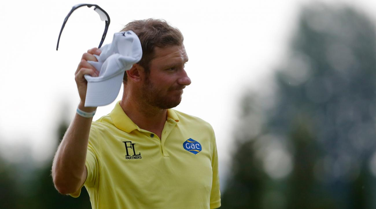 Chris Wood of England gestures as he leaves the 18th hole during the Lyoness Open at the Diamond Country Club on June 14, 2015, in Atzenbrugg, Austria.