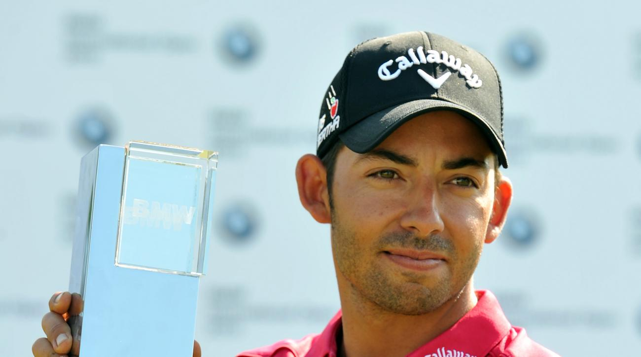 Pablo Larrazabal of Spain holds the trophy after winning the BMW International Open in Munich, Germany, Sunday, June 28, 2015.