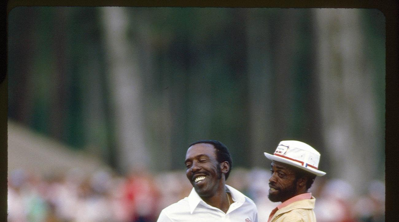 "1985 Players Championship: Winner Calvin Peete with caddie ""Golf Ball"" Dolphus Hull."