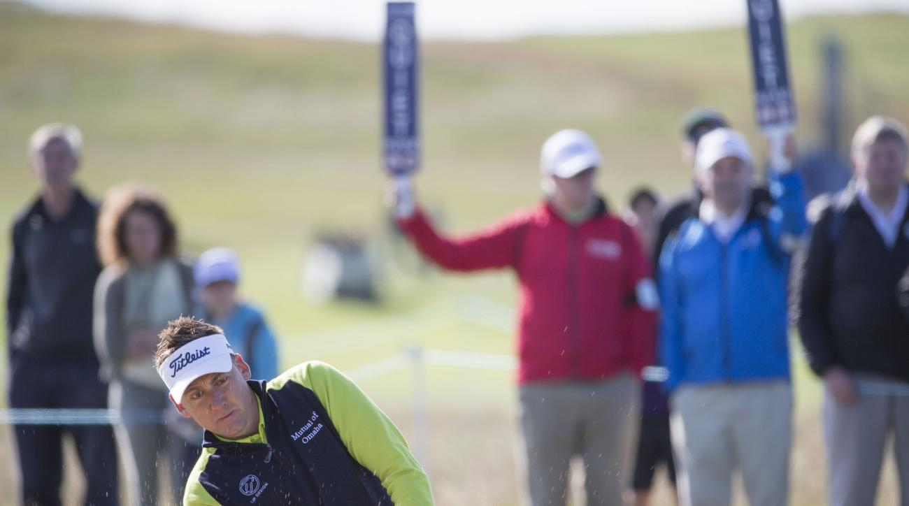 England's Ian Poulter plays from the green side bunker on the 2nd hole during day one of the Scottish Open at Gullane Golf Club, in Gullane Scotland Thursday July 9, 2015. (Kenny Smith/PA via AP) UNITED KINGDOM OUT  NO SALES NO