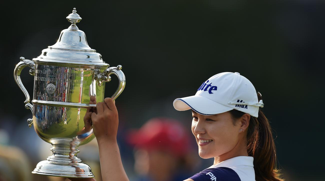 In Gee Chun poses with the trophy following her U.S. Women's Open victory.