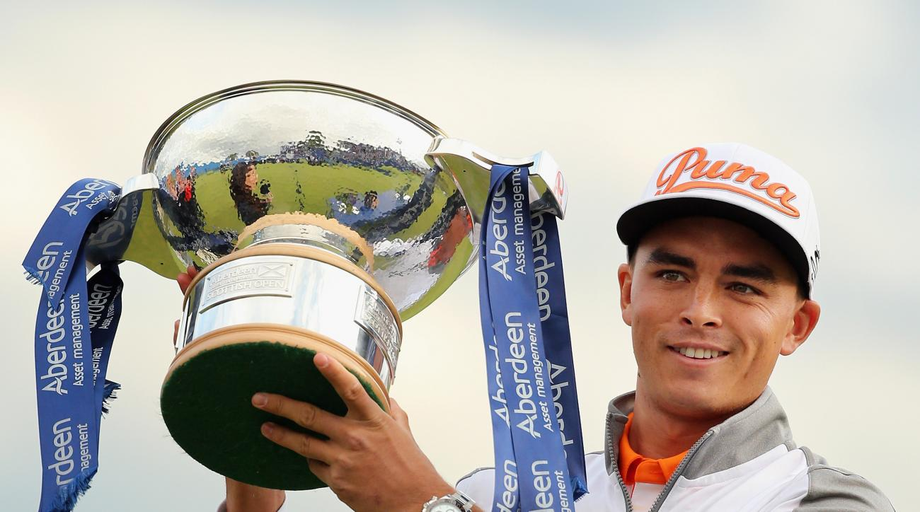 Rickie Fowler poses with the trophy following his Scottish Open victory.