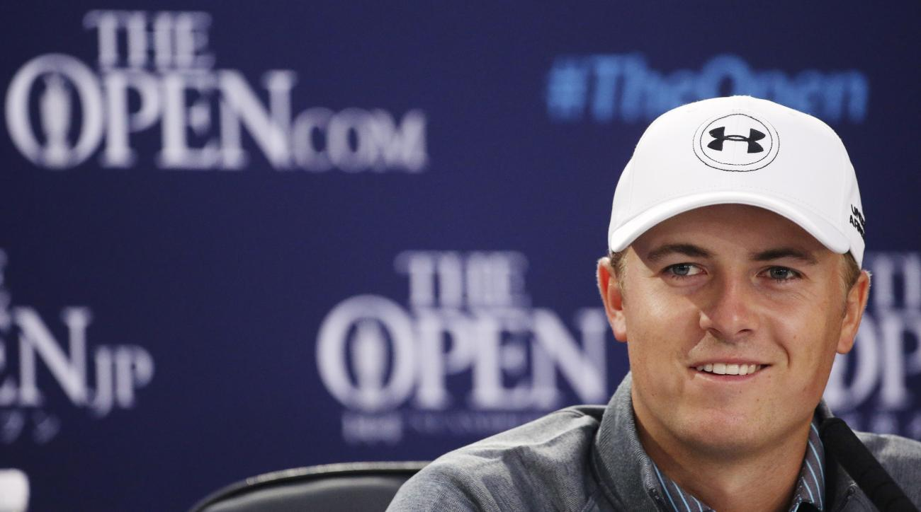 United States' Jordan Spieth smiles during a news conference ahead of a practice round at the British Open Golf Championship at the Old Course, St. Andrews, Scotland, Wednesday, July 15, 2015. (AP Photo/Peter