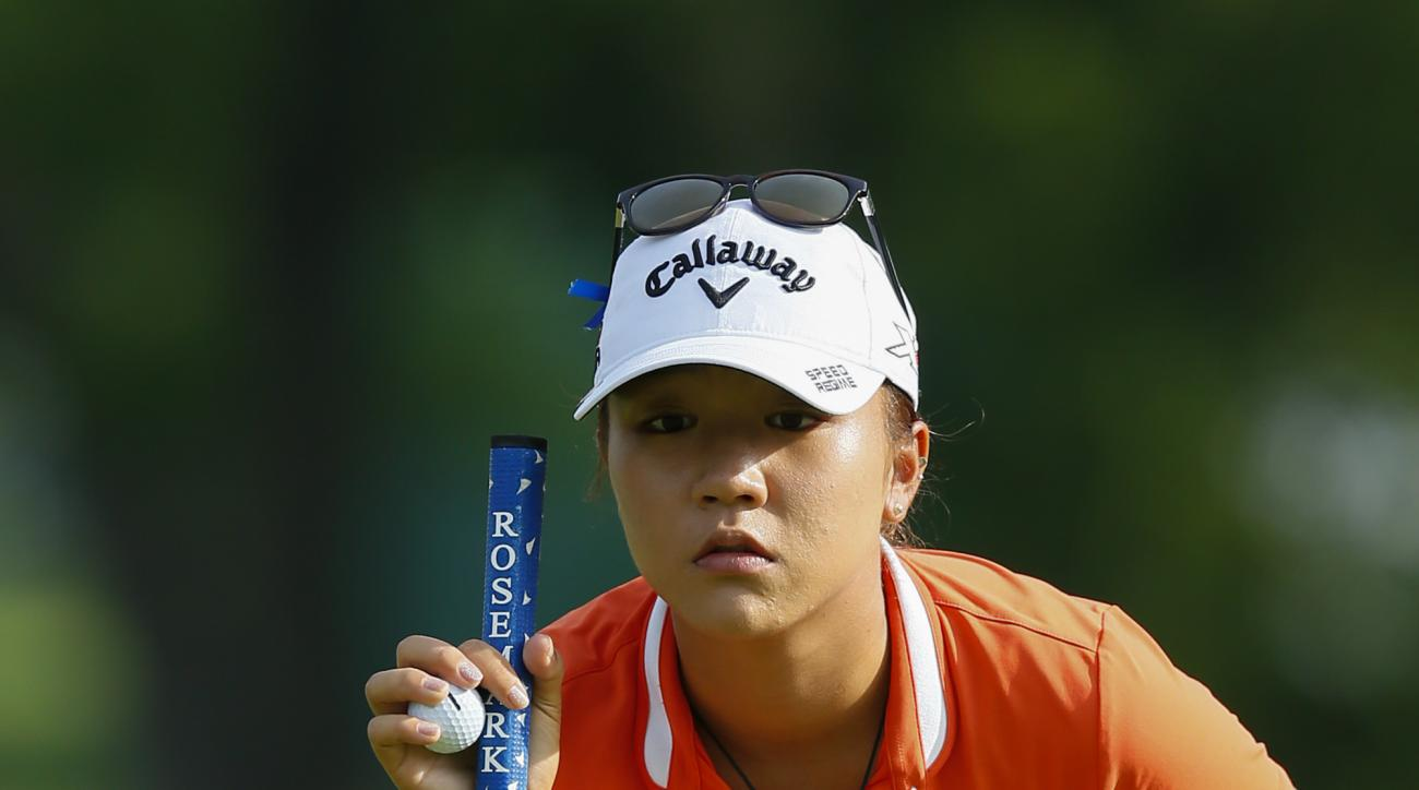 Lydia Ko of New Zealand lines up a putt on the first green during the Marathon Classic last week.
