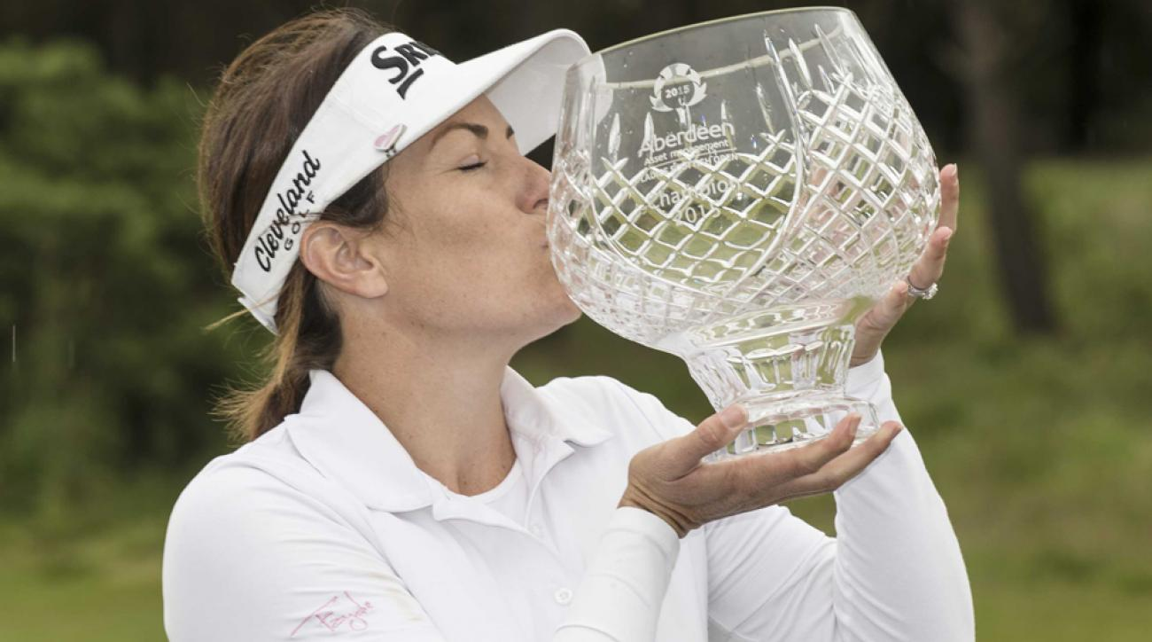 Rebecca Artis of Australia poses with the trophy after wining the  Aberdeen Asset Management Scottish Ladies Open at Dundonald Links Golf Course on Sunday, July 26, 2015, in Troon, Scotland.