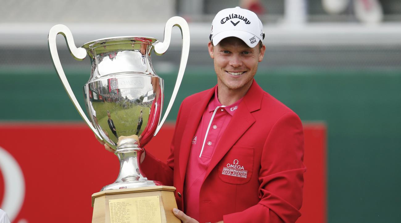 Winner Danny Willett of England poses with the trophy after the final round of the Omega European Masters in Crans-Montana, Switzerland, Sunday, July 26, 2015.