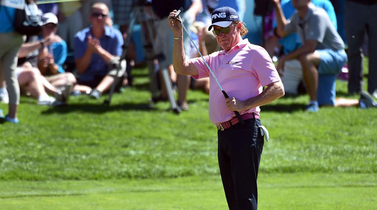 Miguel Angel Jimenez of Spain celebrates after sinking an eagle putt on 18 by putting his putter away like a sword during the second round of the Shaw Charity Classic at the Canyon Meadows Golf & Country Club on August 08, 2015 in Calgary, Canada. Jimenez