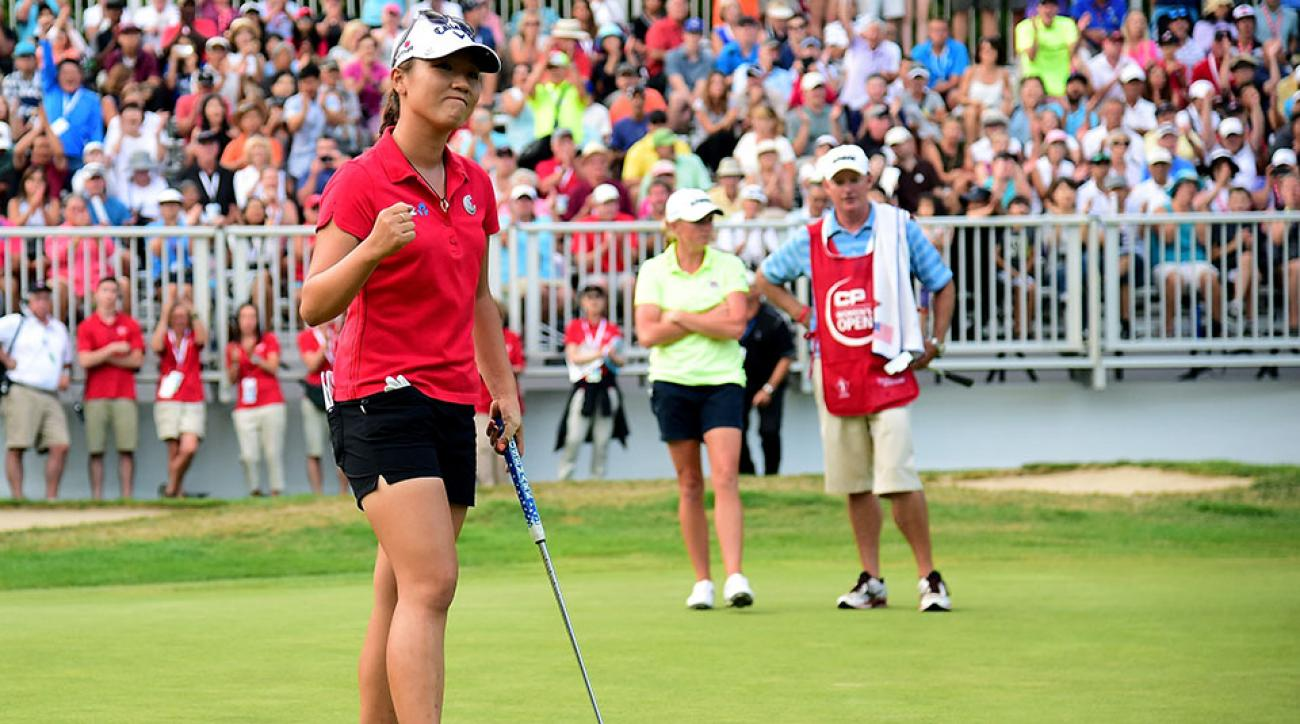 Lydia Ko of New Zealand celebrates her putt to beat Stacy Lewis on the first playoff hole during the final round of the Canadian Pacific Women's Open at the Vancouver Golf Club on August 23, 2015 in Vancouver, Canada.