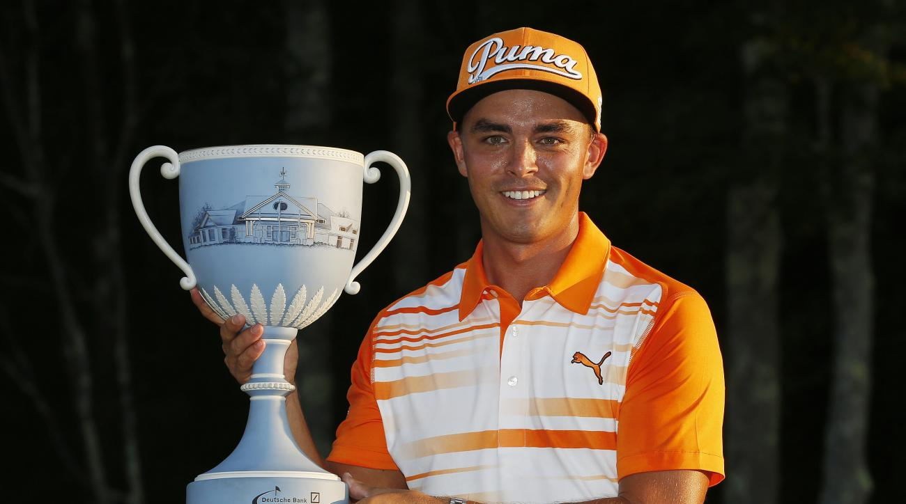 Rickie Fowler holds the trophy after winning the 2015 Deutsche Bank Championship.