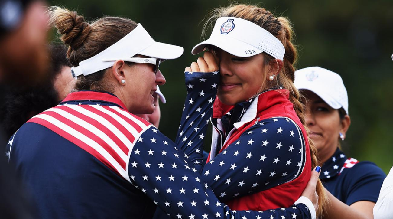 Alison Lee of team USA cries shortly after she was told that her short putt on the 17th hole had not been conceeded and thus loosing the hole to Europe during the continuation of the darkness delayed fourball matches at the Solheim Cup on Sunday.