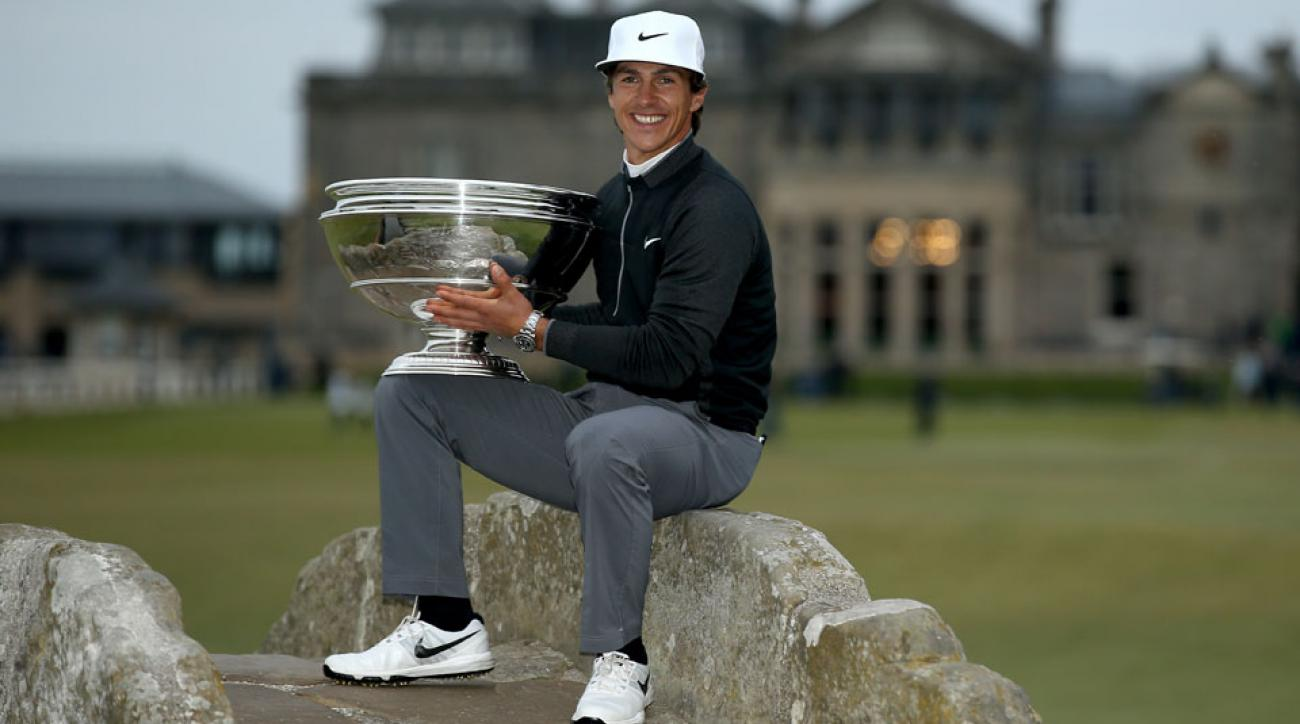 Thorbjorn Olesen holds the trophy on the Swilcan Bridge after winning the 2015 Alfred Dunhill Links.