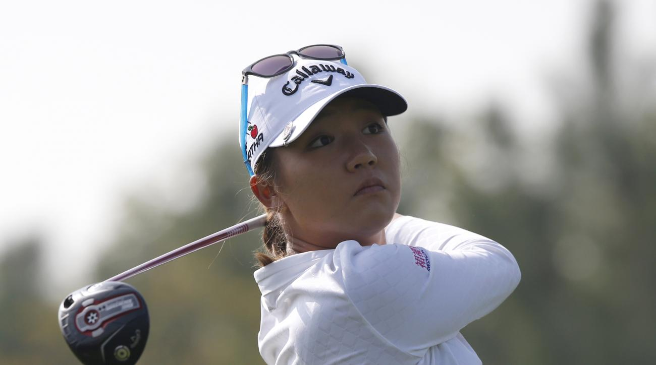 Lydia Ko of New Zealand watches her shot on the second hole during the third round of the LPGA KEB Hana Bank Championship golf tournament at Sky72 Golf Club in Incheon, South Korea, Saturday, Oct. 17, 2015. (AP Photo/Lee