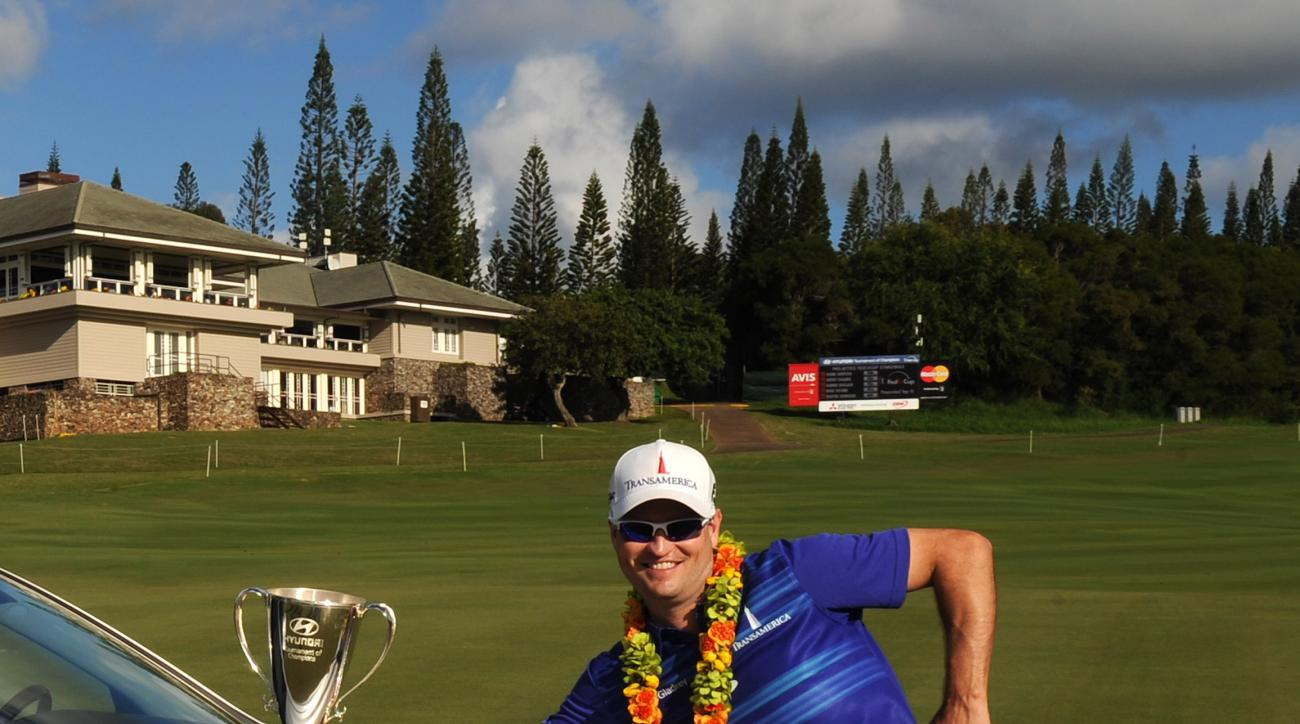 Zach Johnson poses with his prizes at the 2014 Hyundai Tournament of Champions