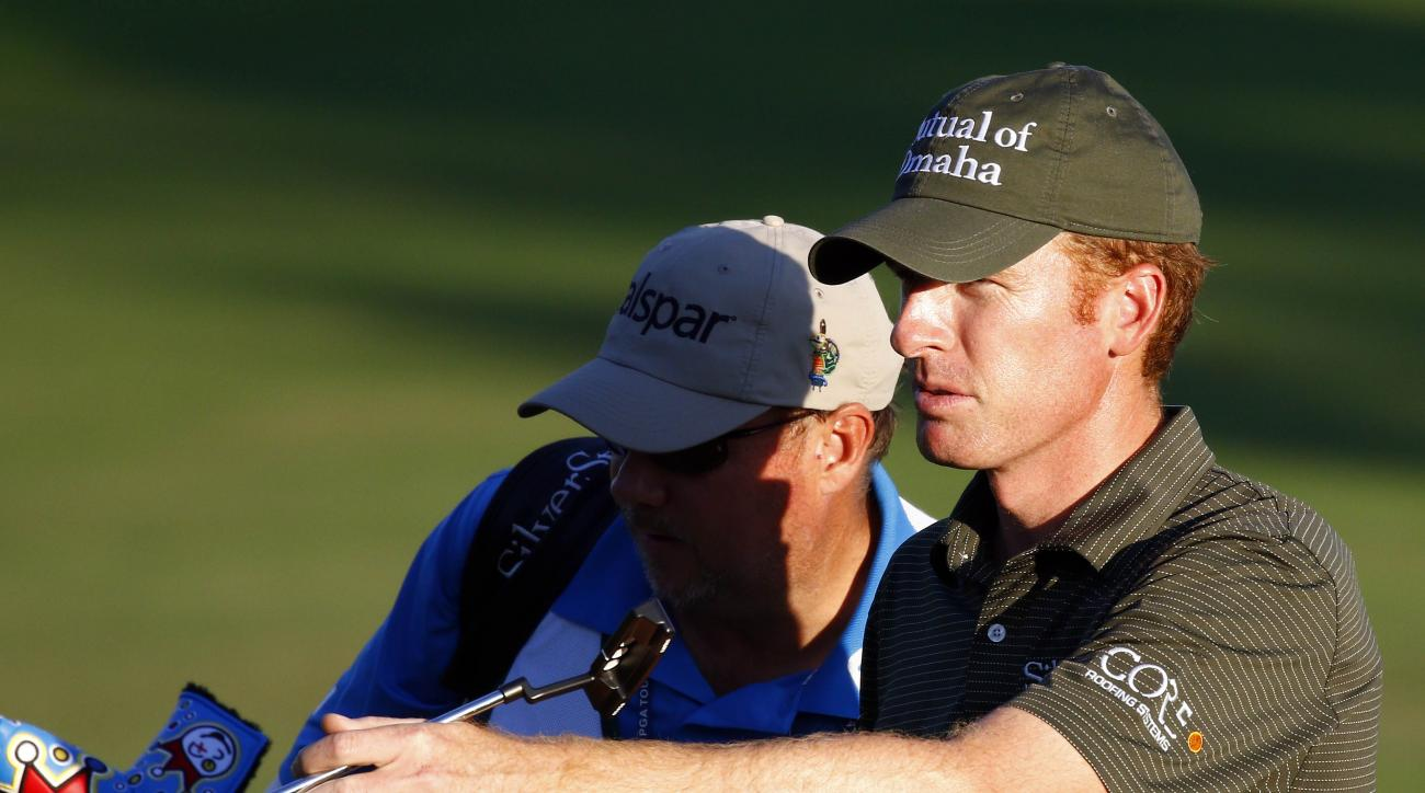 Roberto Castro directs, right, his caddie to his ball on the final hole in the first round of the Sanderson Farms Classic golf tournament in Jackson, Miss.,Thursday, Nov 5, 2015. (AP Photo/Rogelio V.