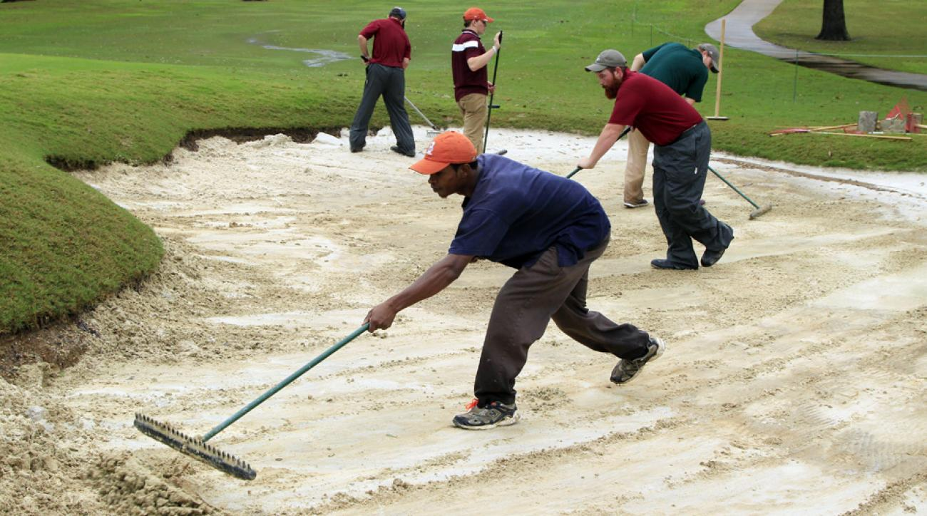 Grounds crews clean up the course after heavy rains during a continuation of the second round of the Sanderson Farms Championship at The Country Club of Jackson on Saturday, Nov. 7, 2015, in Jackson, Mississippi.