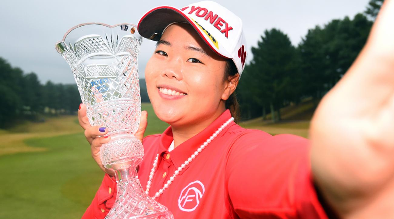 Sun-Ju Ahn of South Korea poses with the trophy after winning the TOTO Japan Classic 2015 at the Kintetsu Kashikojima Country Club on Sunday, Nov. 8, 2015, in Shima, Japan.