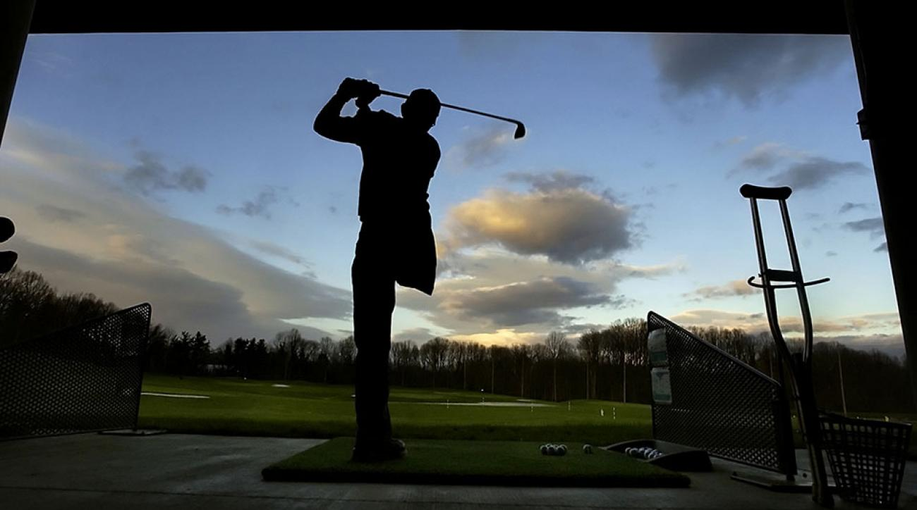 Spc. Sean Lewis watches his ball at Olney Golf Park in Olney, Maryland, where wounded soldiers can hit golf balls for free.