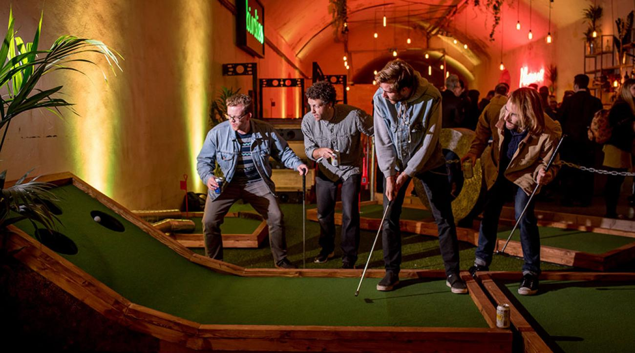 Golfers on the course at London's Birdies Crazy Golf Club, which opens today.