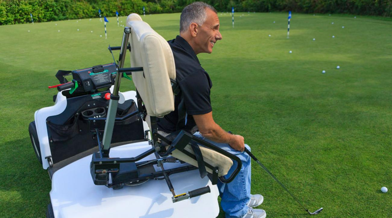 A man with a spinal cord injury in an adaptive cart on a golf course.