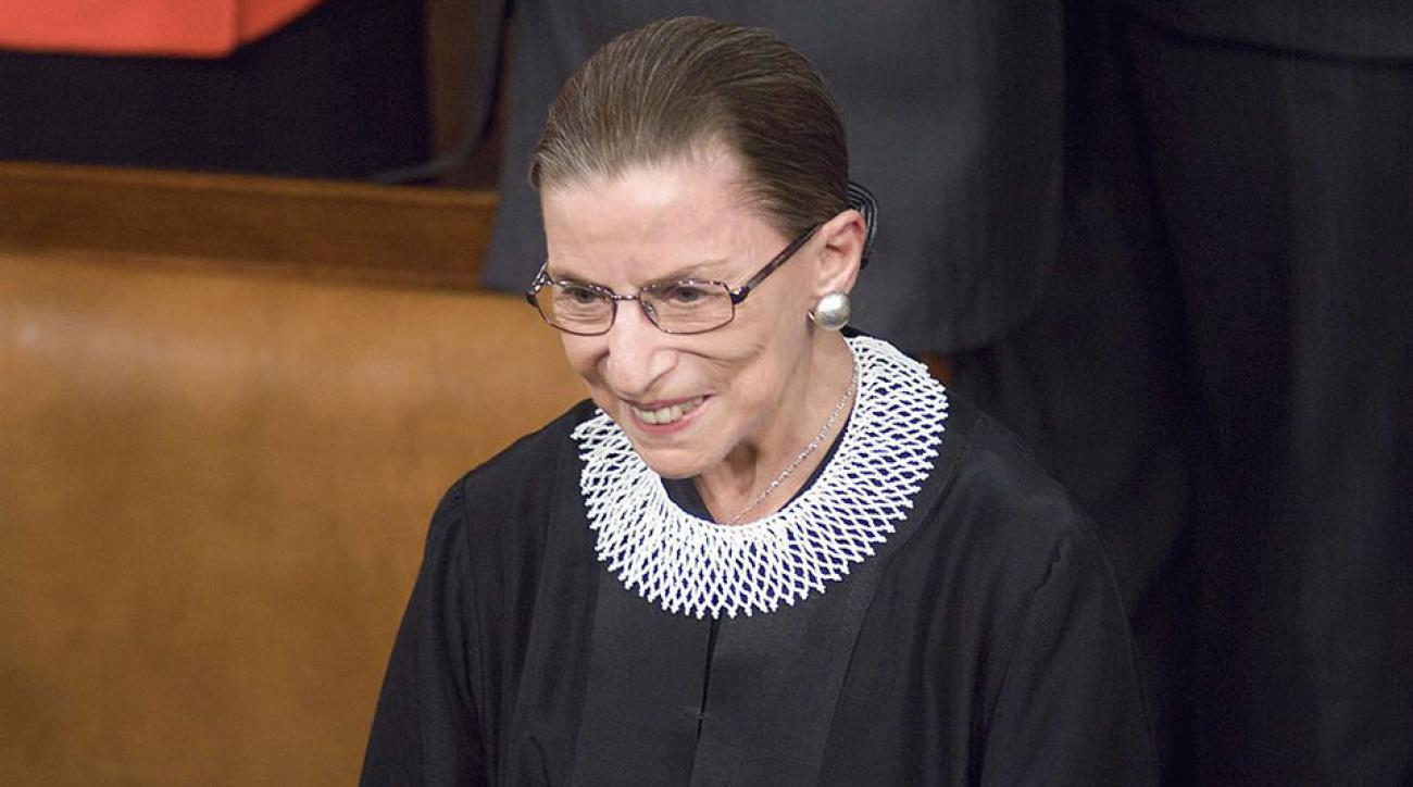 Supreme Court Justice Ruth Bader Ginsberg arrives in the House chamber before Barack Obama's first address to a joint session of the U.S. Congress.