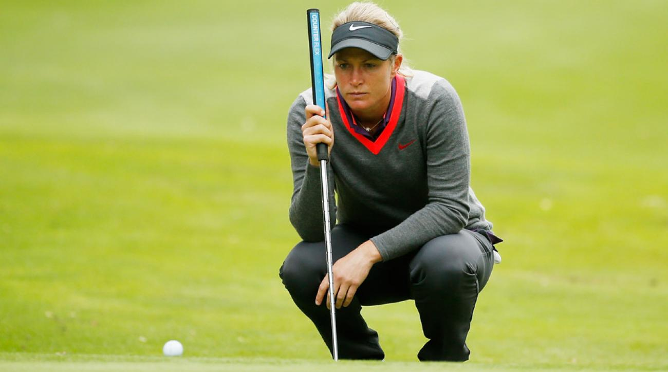 Suzann Pettersen of Norway lines up a putt on the third hole during the third round of the Lorena Ochoa Invitational .