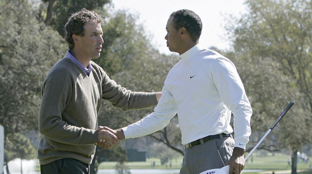 Stephen Ames congratulates Tiger Woods after Woods won their match during the first round of the 2006 Accenture Match Play Championship at the La Costa Resort & Spa in Carlsbad, California on February 22, 2006.
