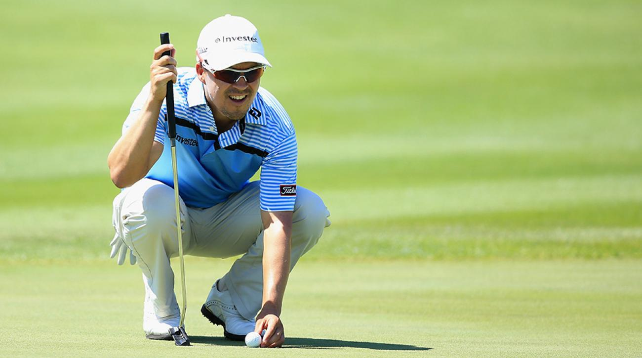 Christiaan Basson of South Africa lines up a putt on the 9th green during day one of the Alfred Dunhill Championship at Leopard Creek Country Golf Club on November 26, 2015 in Malelane, South Africa.