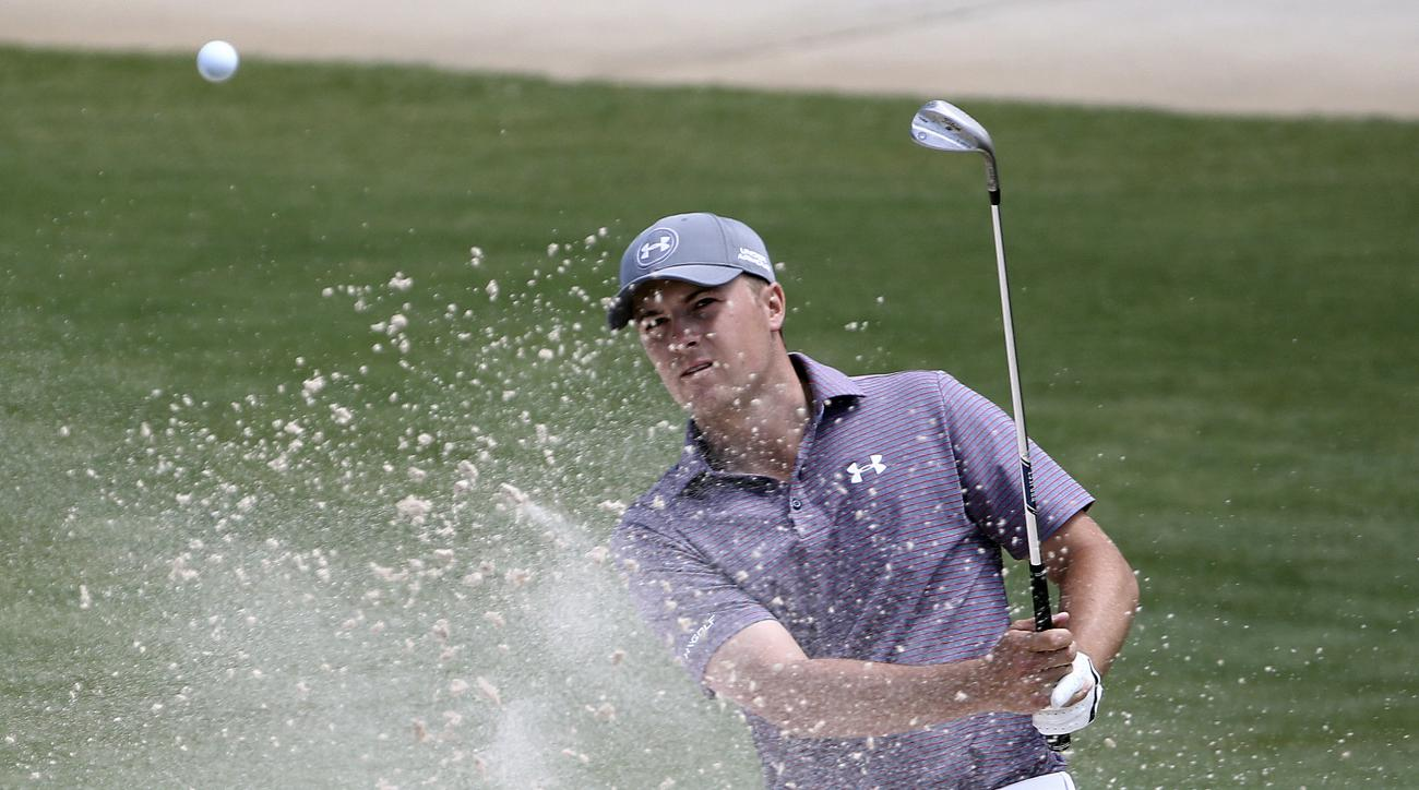 Jordan Spieth of the U.S. plays a shot out of a bunker on the 8th hole during the Australia Open Golf Tournament in Sydney, Australia, Friday, Nov. 27, 2015. (AP Photo/Rob