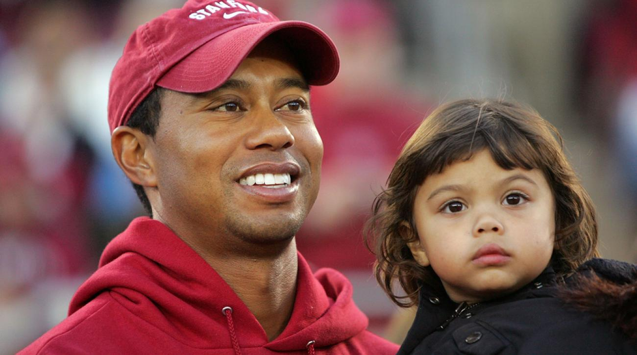 Tiger Woods holds his daugher, Sam, on the sidelines before a Stanford game against the California Bears at Stanford Stadium on Nov. 21, 2009, in Palo Alto, California.