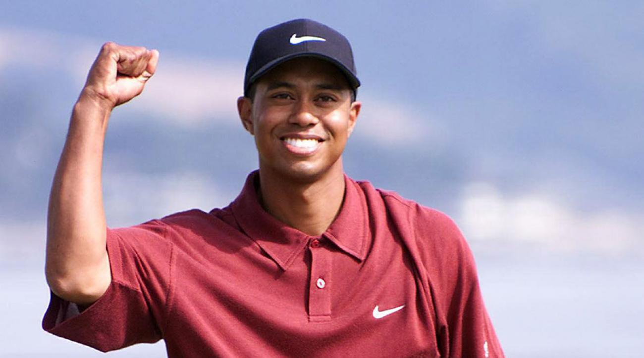 Tiger Woods clinches his fist after winning the 2000 U.S. Open at Pebble Beach. Woods won with a score 12-under-par.