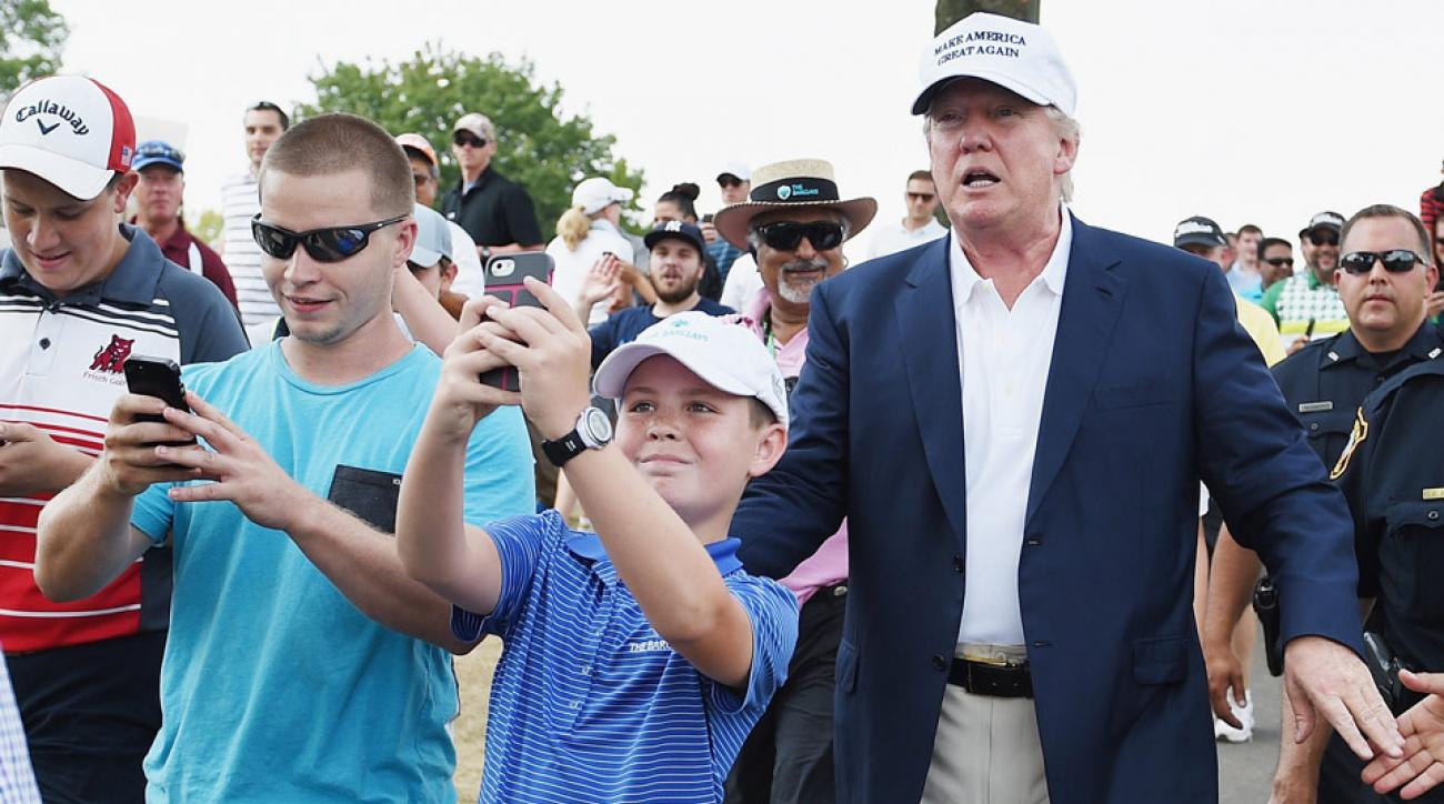 Donald Trump poses for photos with fans at the 2015 Barclays.