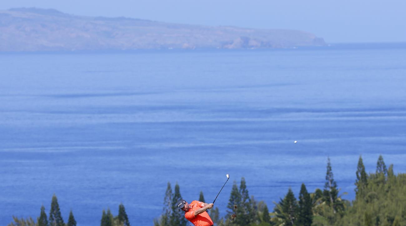 Padraig Harrington hits from the fourth fairway during the second round of the Tournament of Champions golf event Friday, Jan. 8, 2016, at Kapalua Plantation Course in Kapalua, Hawaii. (AP Photo/Matt