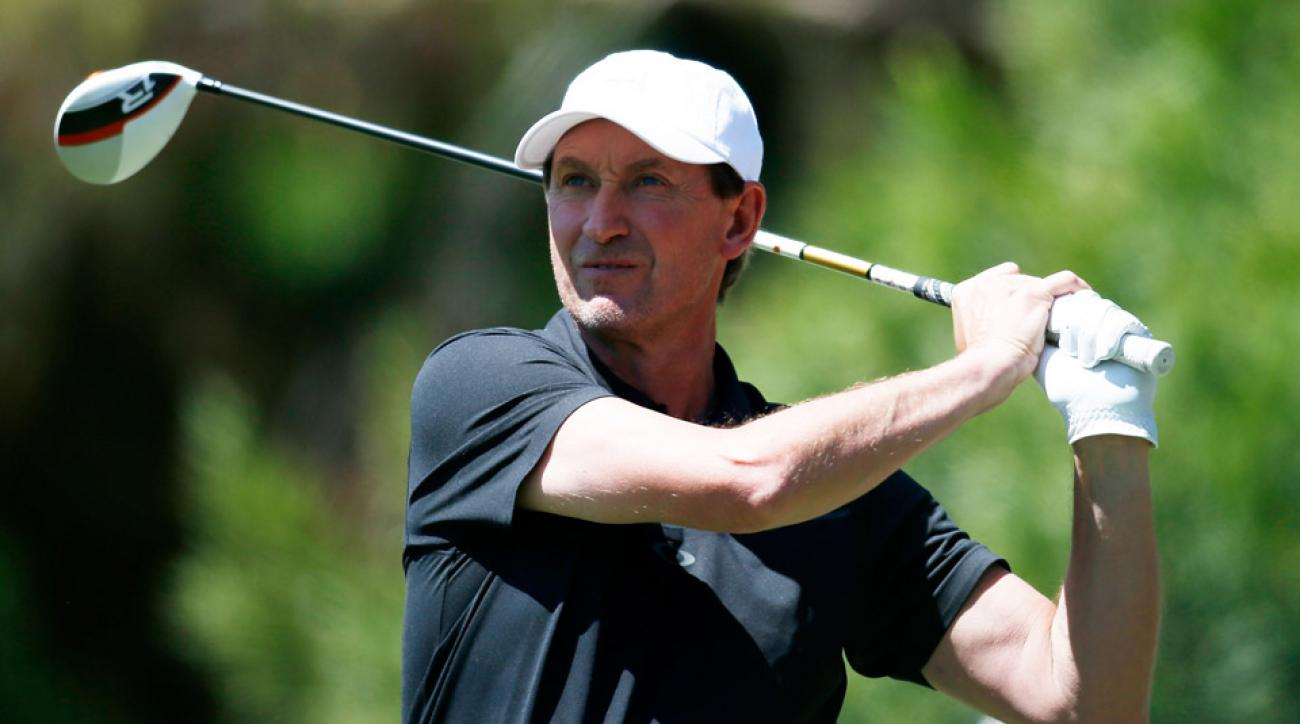 Former NHL player Wayne Gretzky hits a tee shot during ARIA Resort & Casino's 12th annual Michael Jordan Celebrity Invitational golf tournament at Shadow Creek on April 5, 2013 in North Las Vegas, Nevada.
