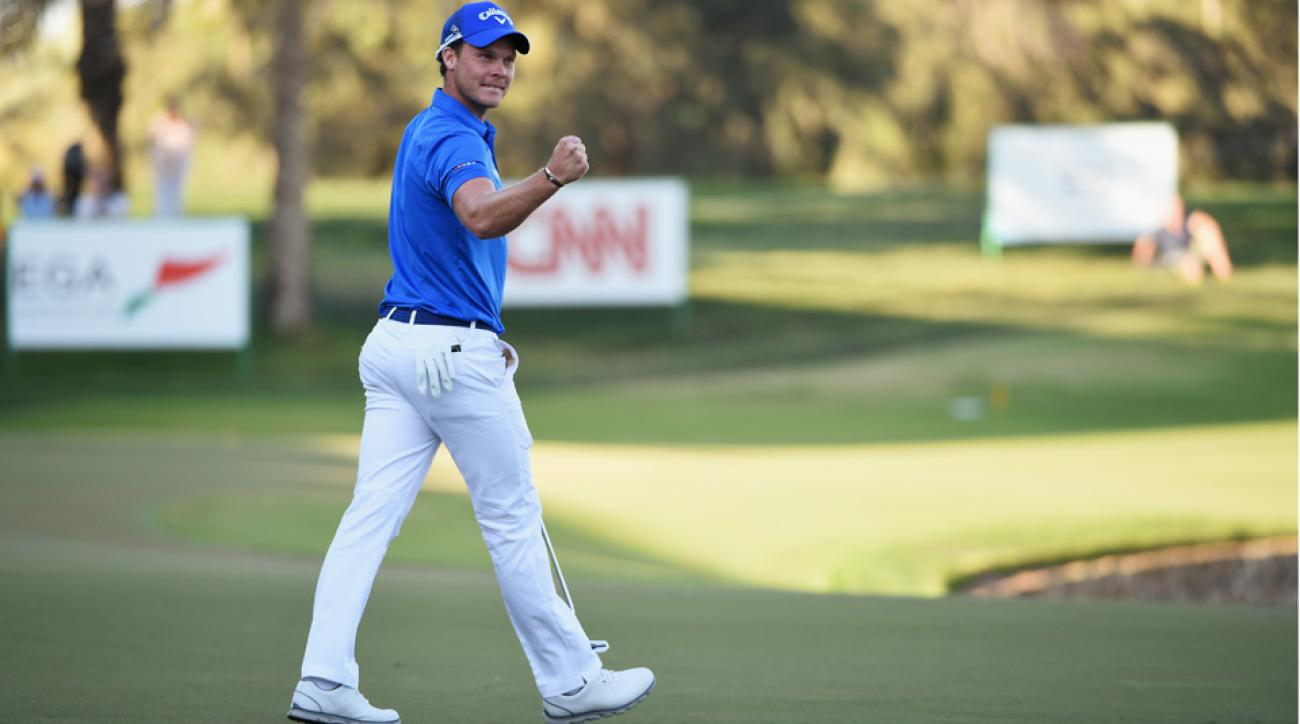 Danny Willett celebrates his victory on the 18th green during the final round of the Omega Dubai Desert Classic at the Emirates Golf Club on Feb. 7, 2016, in Dubai, United Arab Emirates.