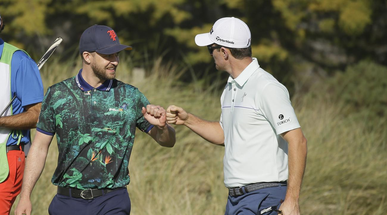 Justin Rose, right, is greeted by playing partner Justin Timberlake, left, after making a birdie on the fourth green of the Spyglass Hill Golf Course during the first round of the AT&T Pebble Beach National Pro-Am golf tournament Thursday, Feb. 11, 2016,