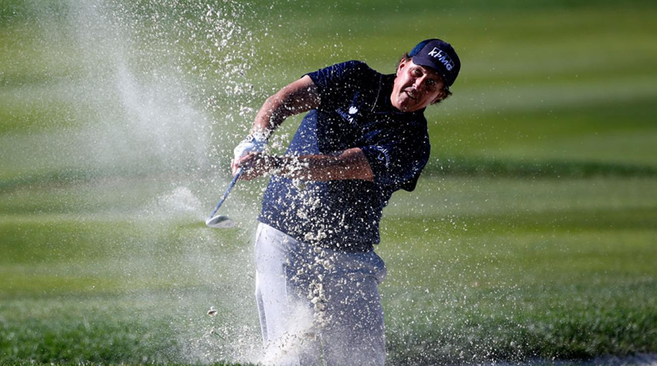 Phil Mickelson plays a shot from the bunker on the fourth hole during round three of the AT&T Pebble Beach National Pro-Am at the Pebble Beach Golf Links on February 13, 2016 in Pebble Beach, California.