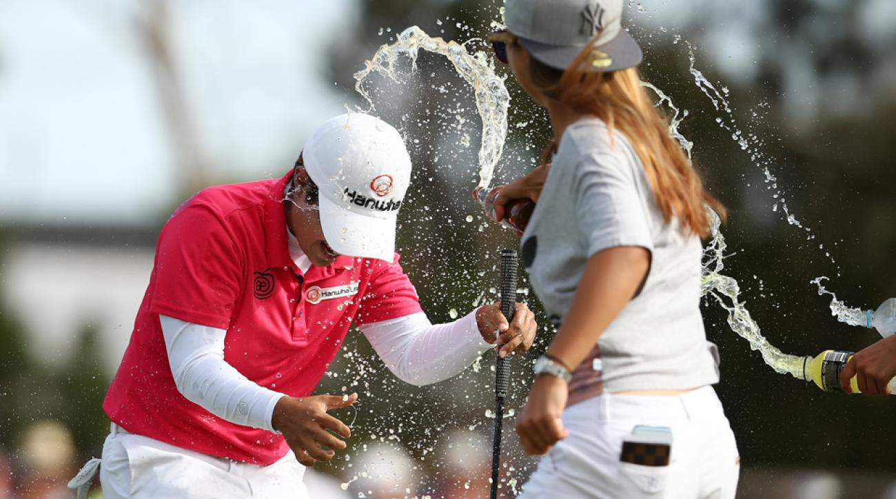 Players dump drinks on the head of Haru Nomura of Japan in celebration after Nomura won the Women's Australian Open at The Grange GC on Feb. 21, 2016, in Adelaide, Australia.