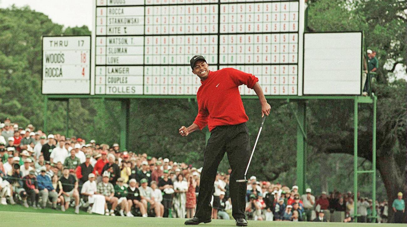Tiger Woods celebrates on the 18th green after winning the 1997 Masters.